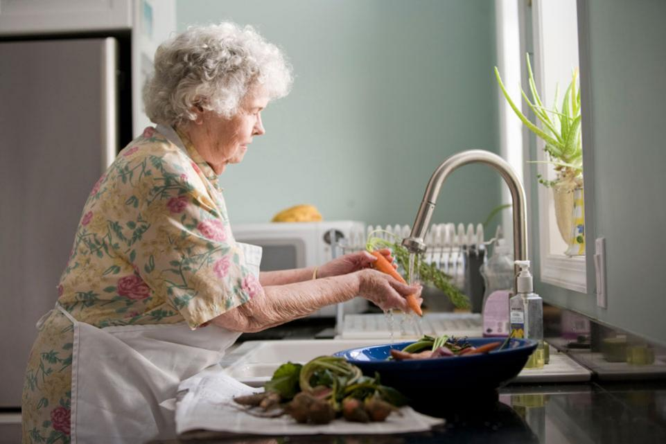 Elderly woman preparing food